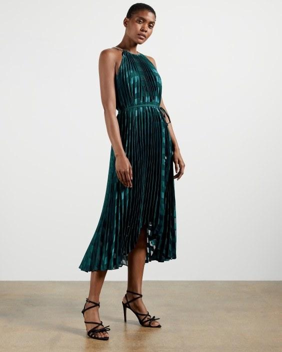 model wearing pleated maxi dress in dark green