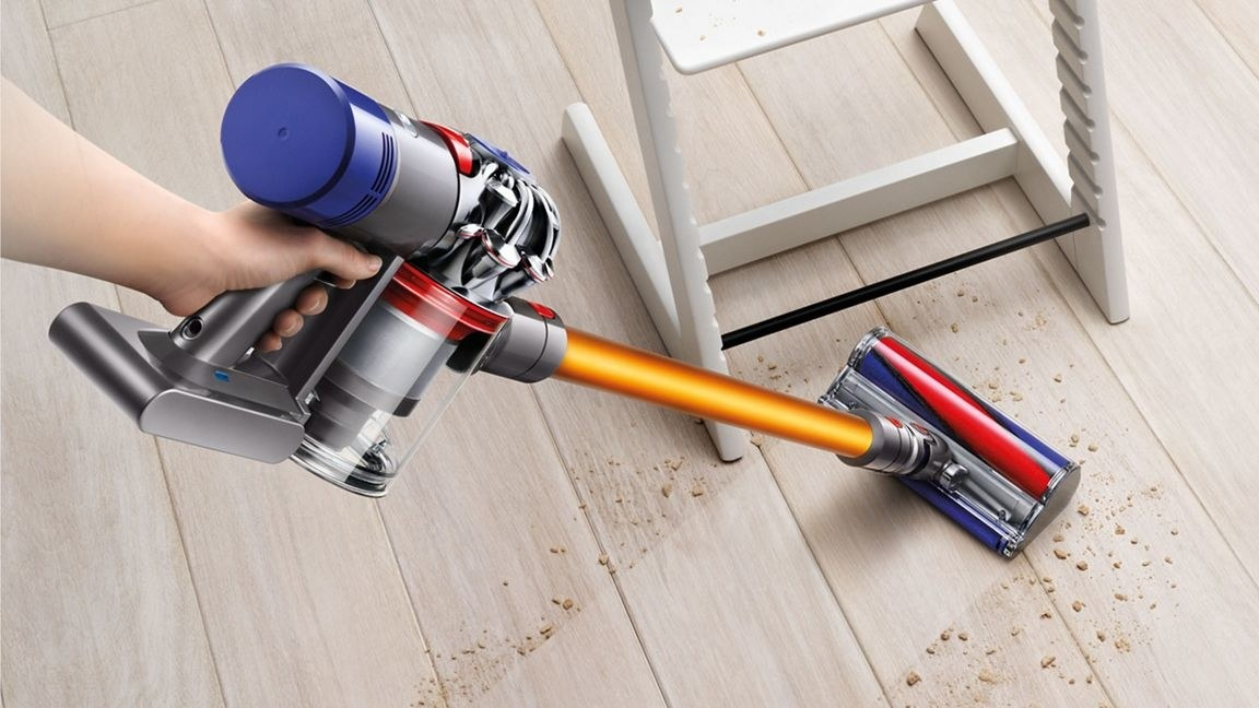 a model using the cordless stick vacuum