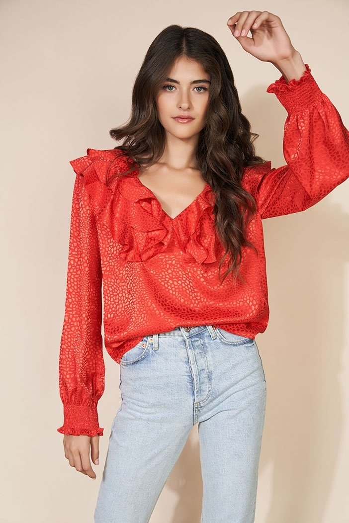 model wearing a ruffle red v-neck top