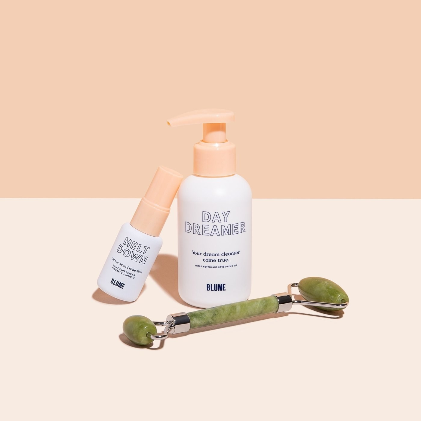 the bundle with a jade roller, acne treatment oil, and a cleanser