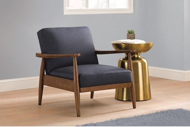low chair with wooden legs and grey fabric