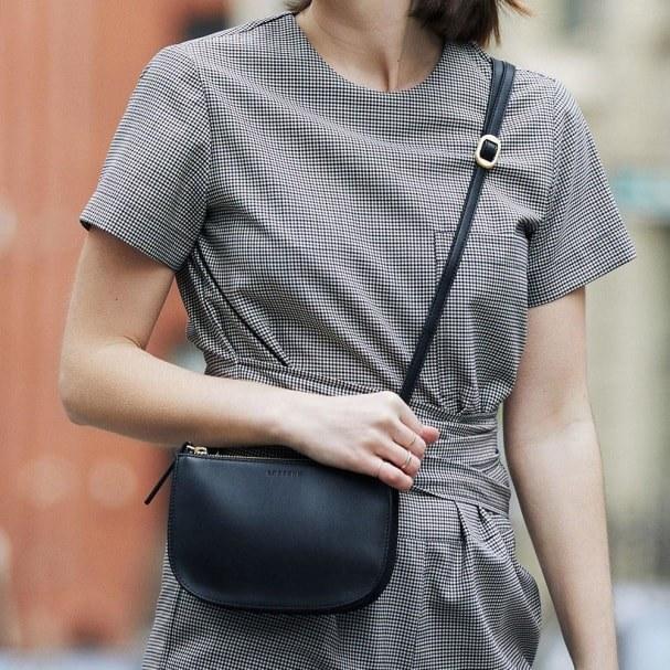 model wearing the crossbody convertible purse