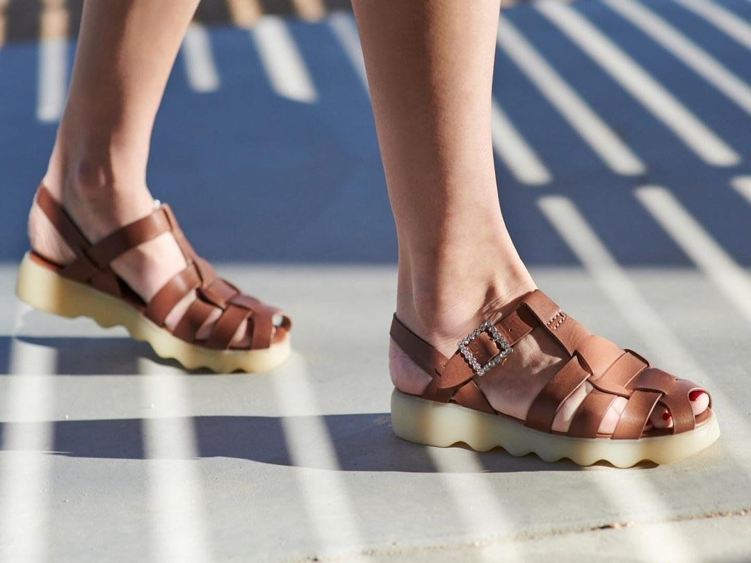 brown strappy closed-toe sandals with a crystal buckle