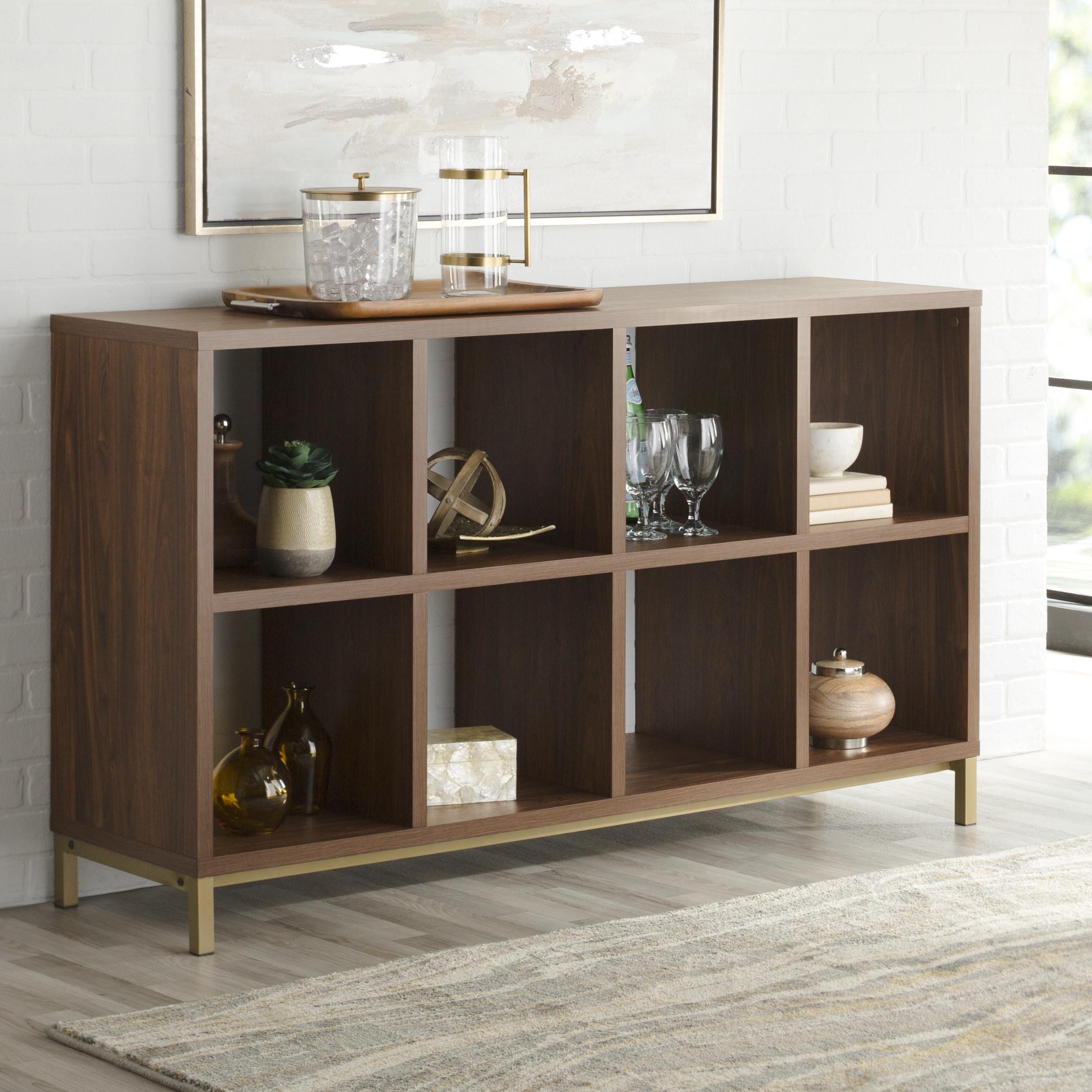 dark wood cube storage organizer with decorative items in it