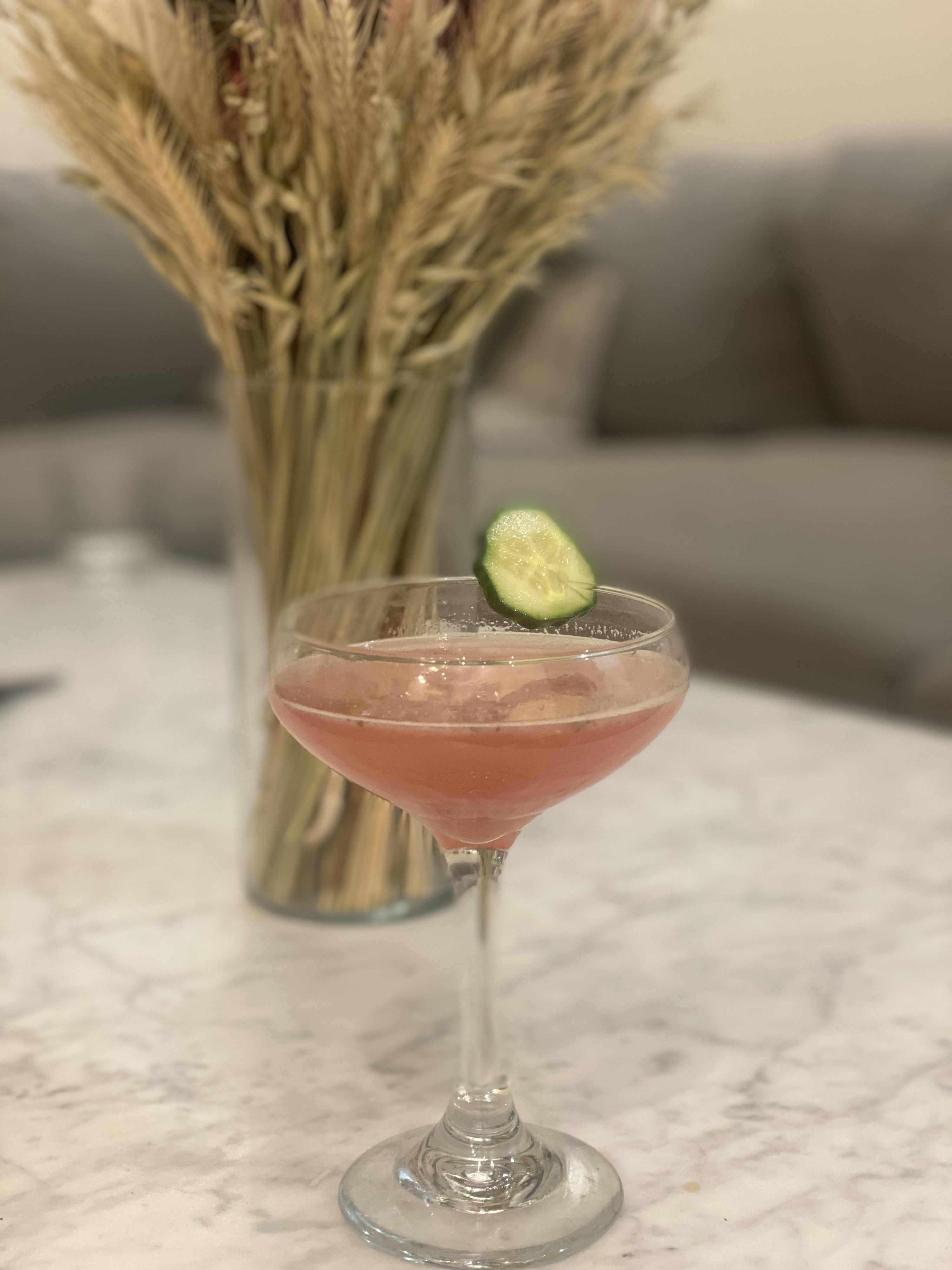 A booze-free Cosmopolitan garnished with a cucumber.