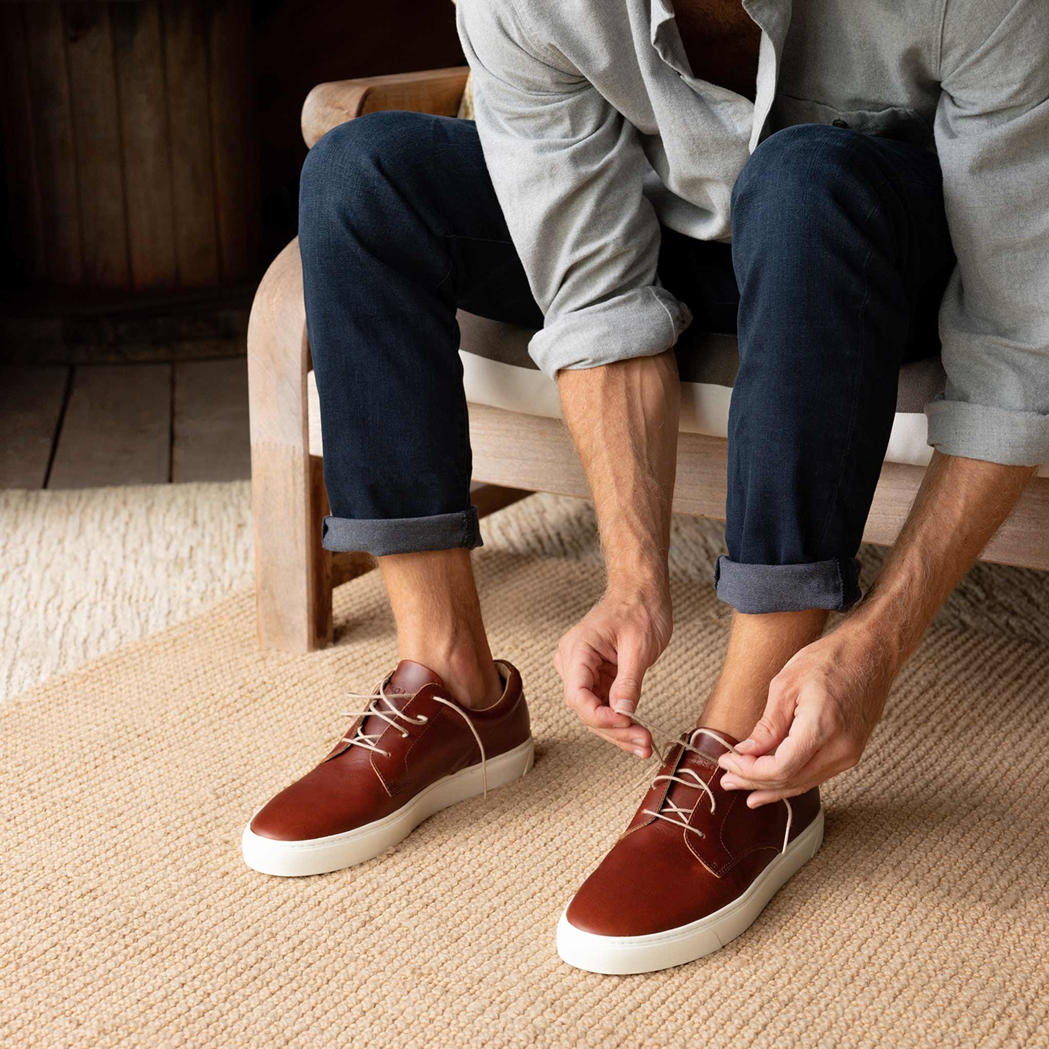 model tying leather shoes
