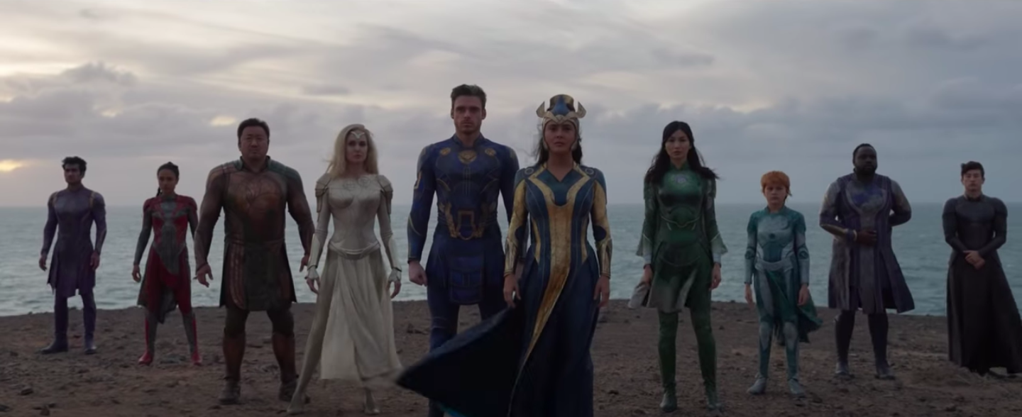 The Eternals standing with the ocean behind them