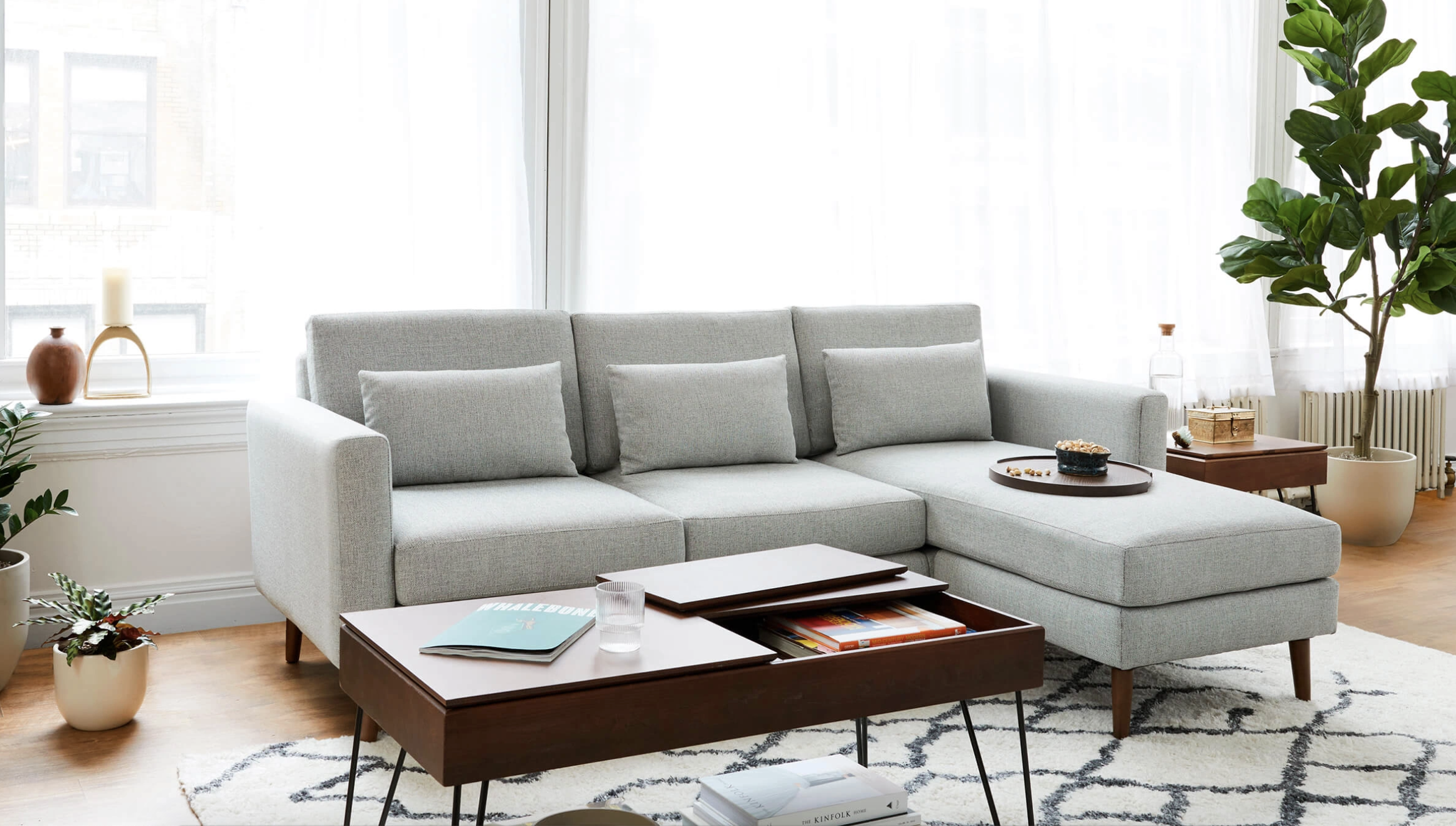 a grey sofa with a chaise
