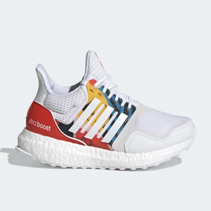 White running shoes with red, yellow, and blue detailing