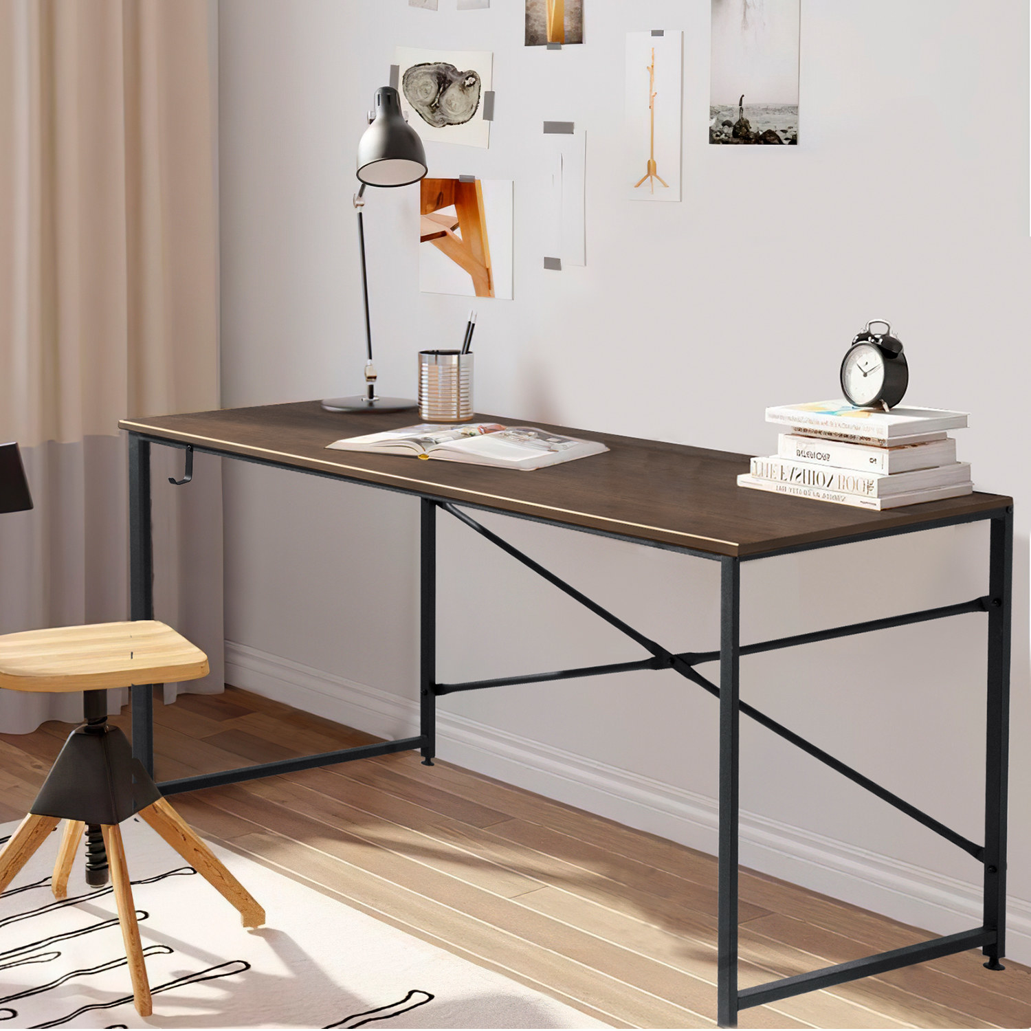 wooden desk with black legs sitting in an at home office