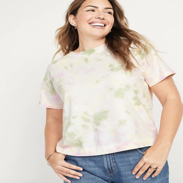 Model in faded green and pink tie dye tee