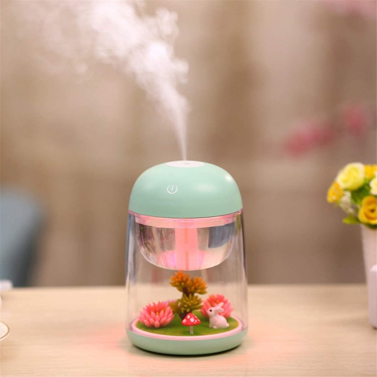 the small blue humidifier with a bunny and mushroom and other plants inside