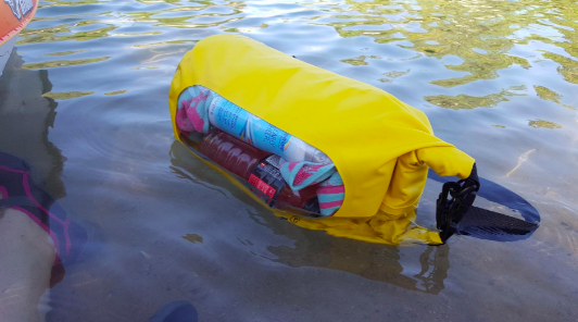 reviewer's bag floating on the water. everything inside is dry.