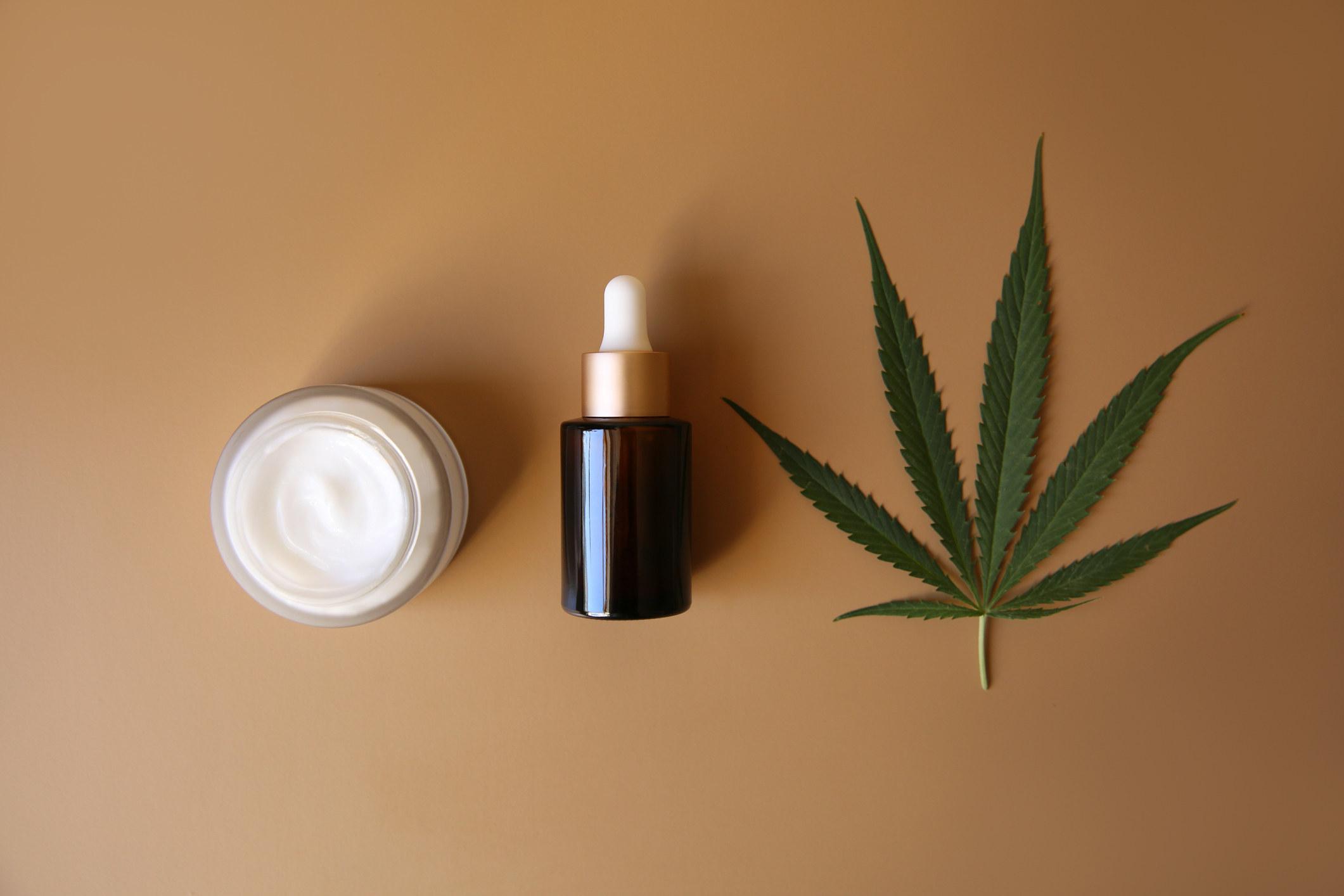 CBD lotion, oil, and a hemp leaf