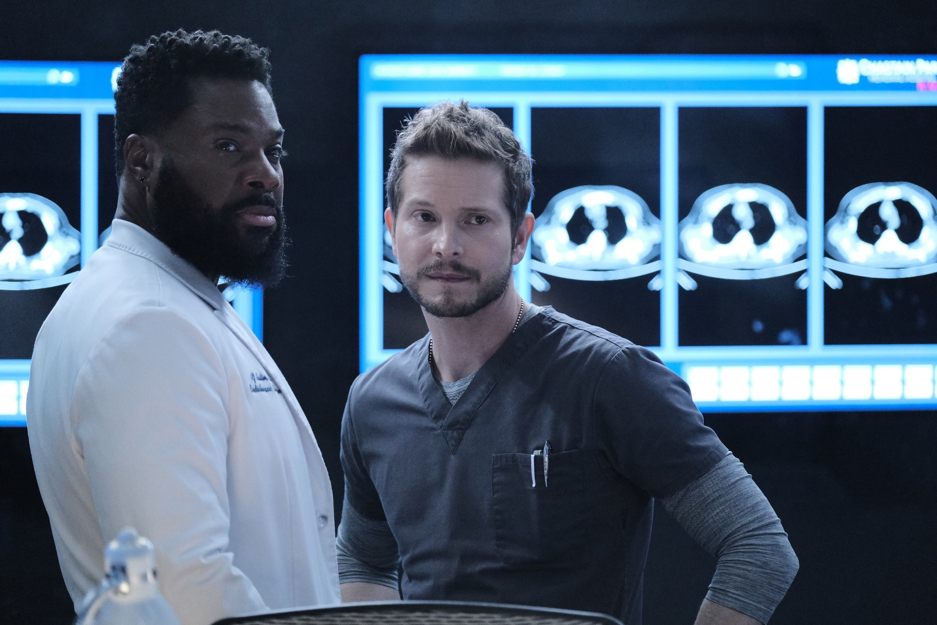 Conrad and AJ contemplating a patient's case on The Resident