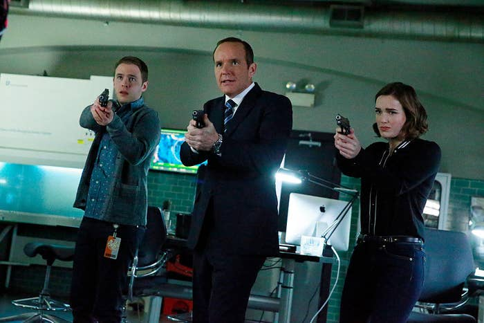 The cast of Agents of SHIELD holding guns