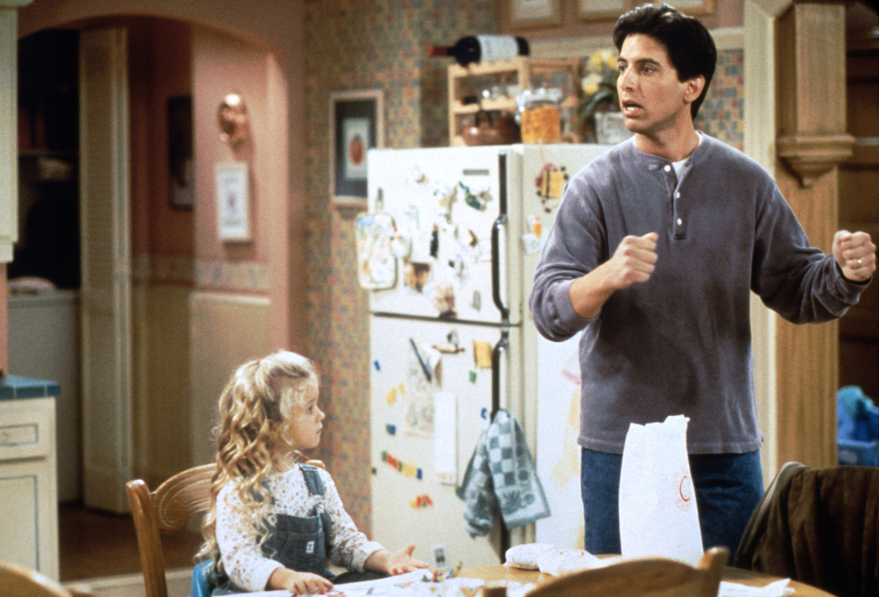 Ray Barone in the kitchen with his young daughter