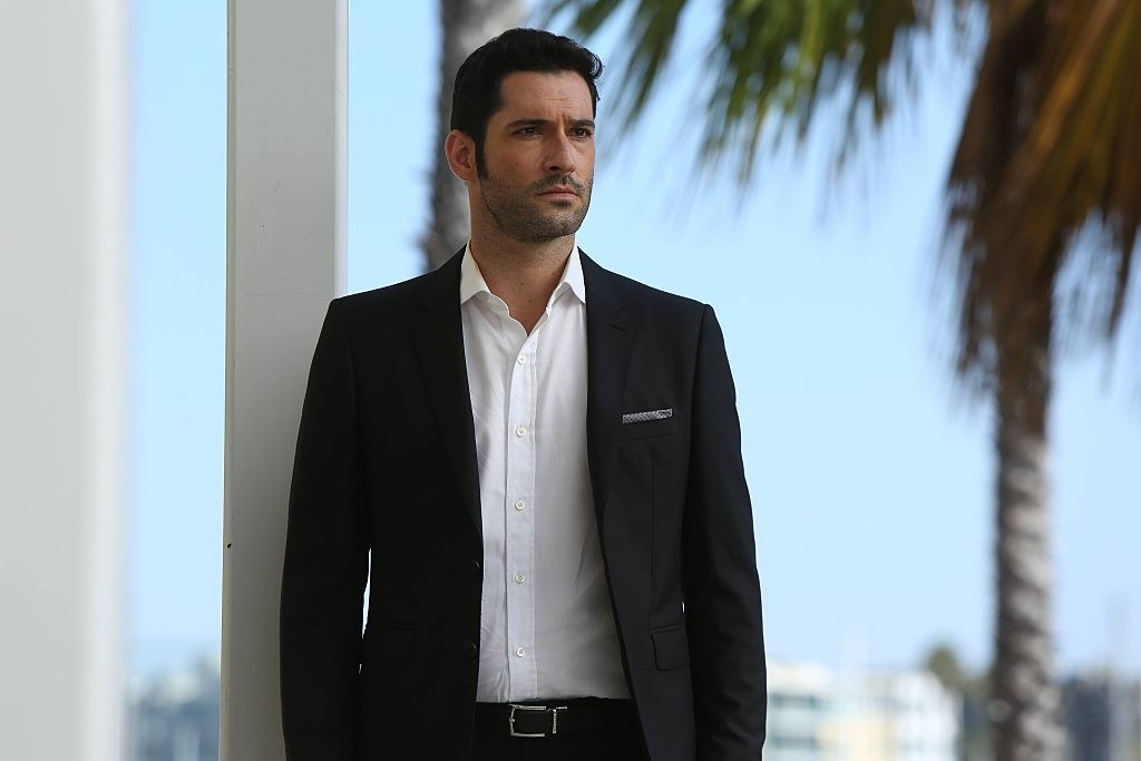 Lucifer standing in a suit
