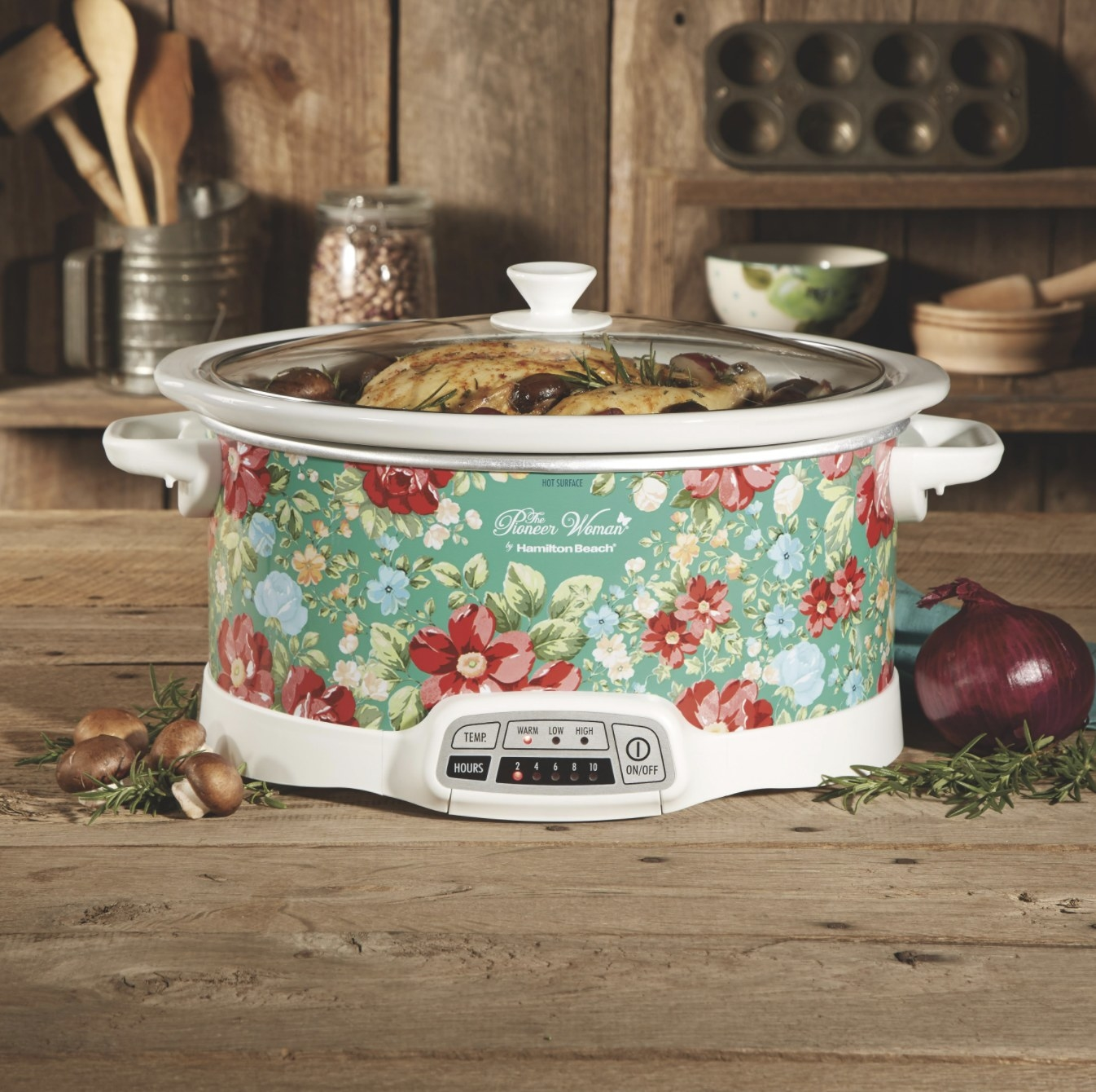 The slow cooker with a floral pattern on it