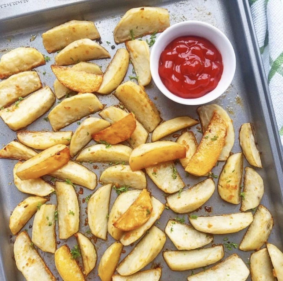 Potato wedges on a sheet pan