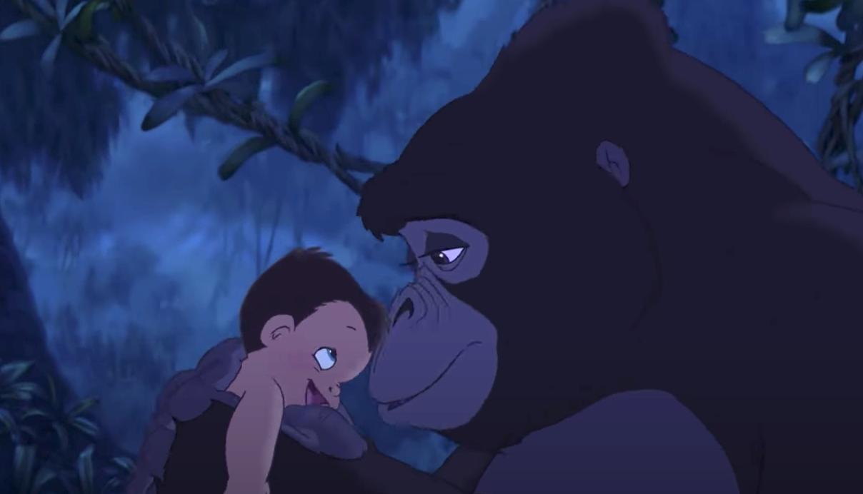 Kala touches her nose to baby Tarzan's head