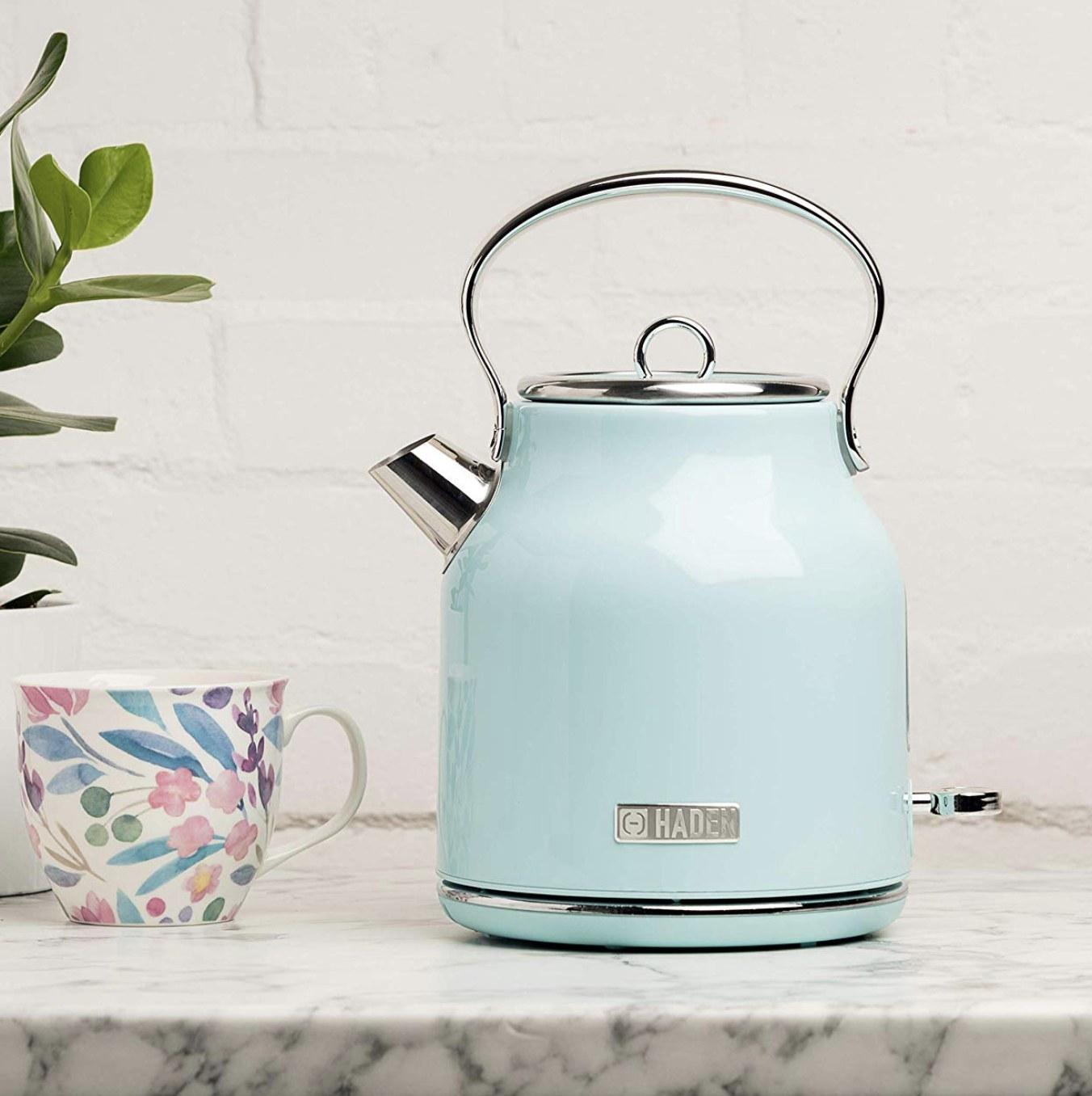 A light blue electric tea kettle