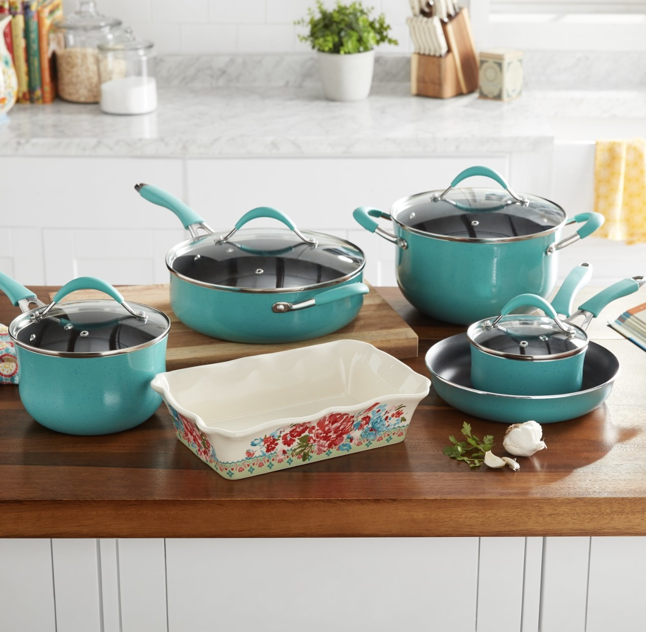 The cookware set in a teal blue