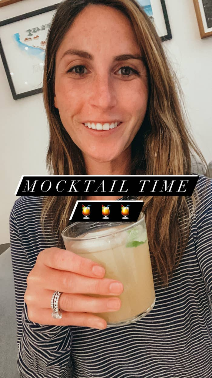 Me drinking a mocktail made with ginger kombucha, lime juice, and Seedlip
