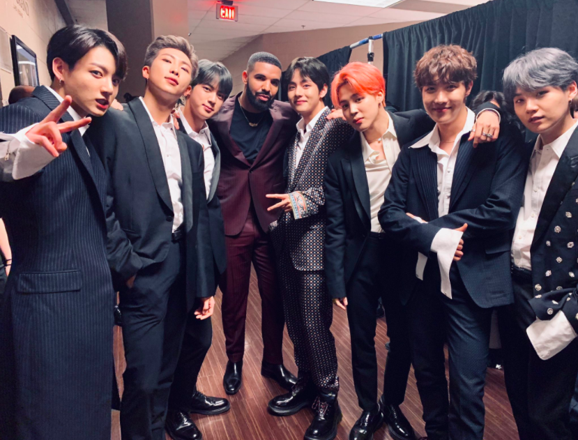 BTS and Drake posing for a photo
