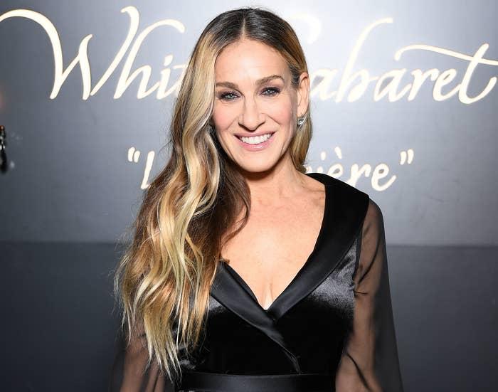 Sarah smiles at an event