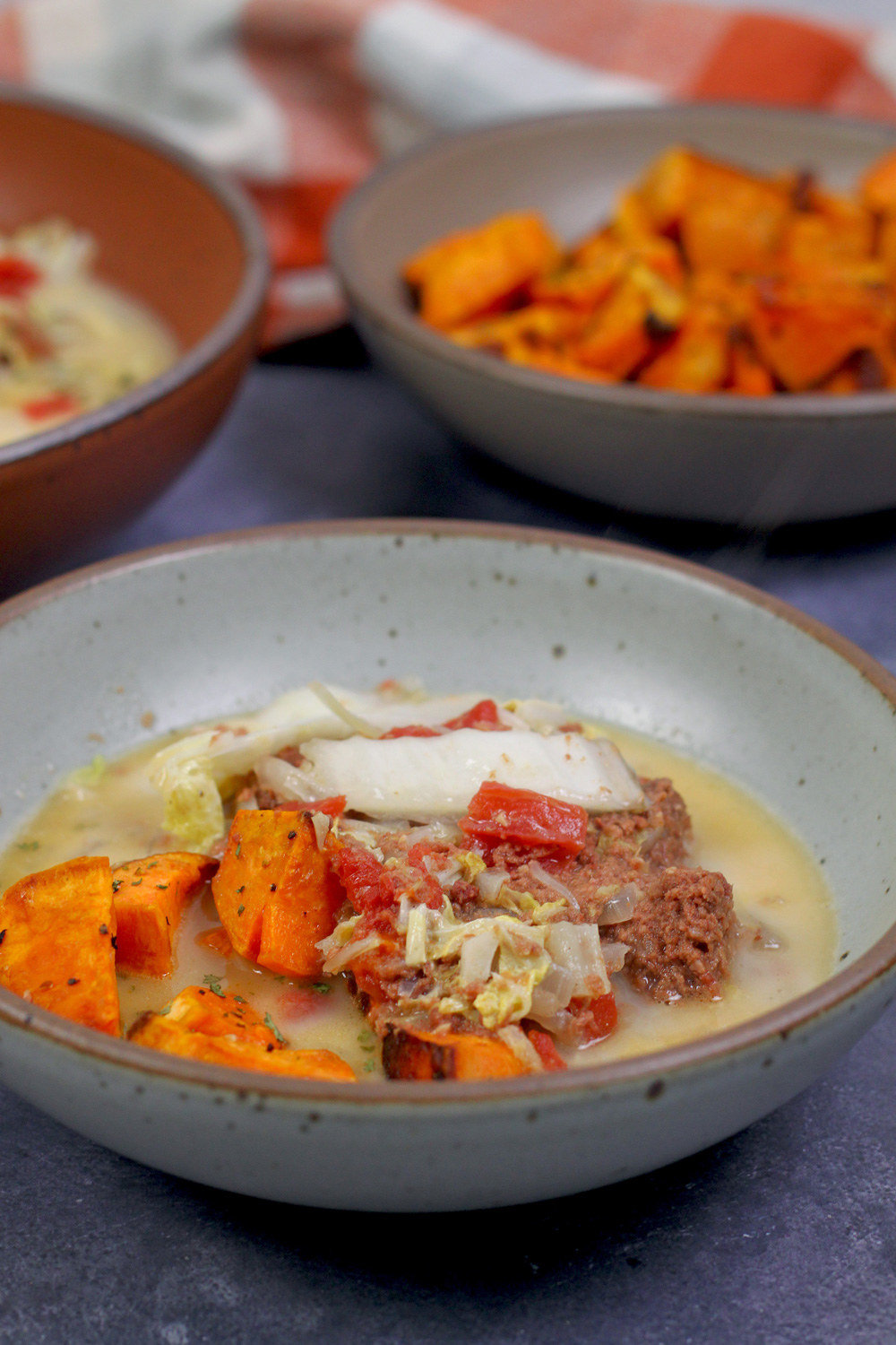 A bowl filled with corned beef and a coconut milk soup