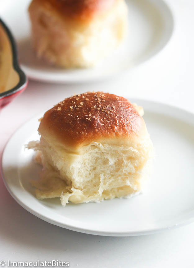 Single sweet bread roll with crunchy, darkened top