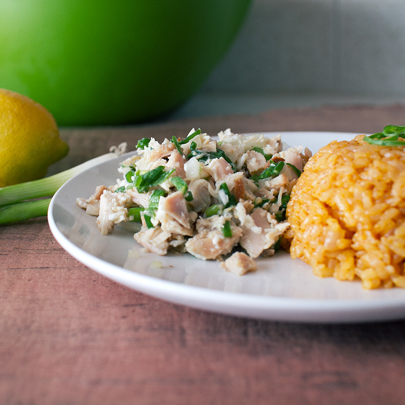 Plate with coconut-mixedchicken salad along with a scoop of rice