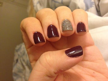 a reviewer with the top coat set to their nails