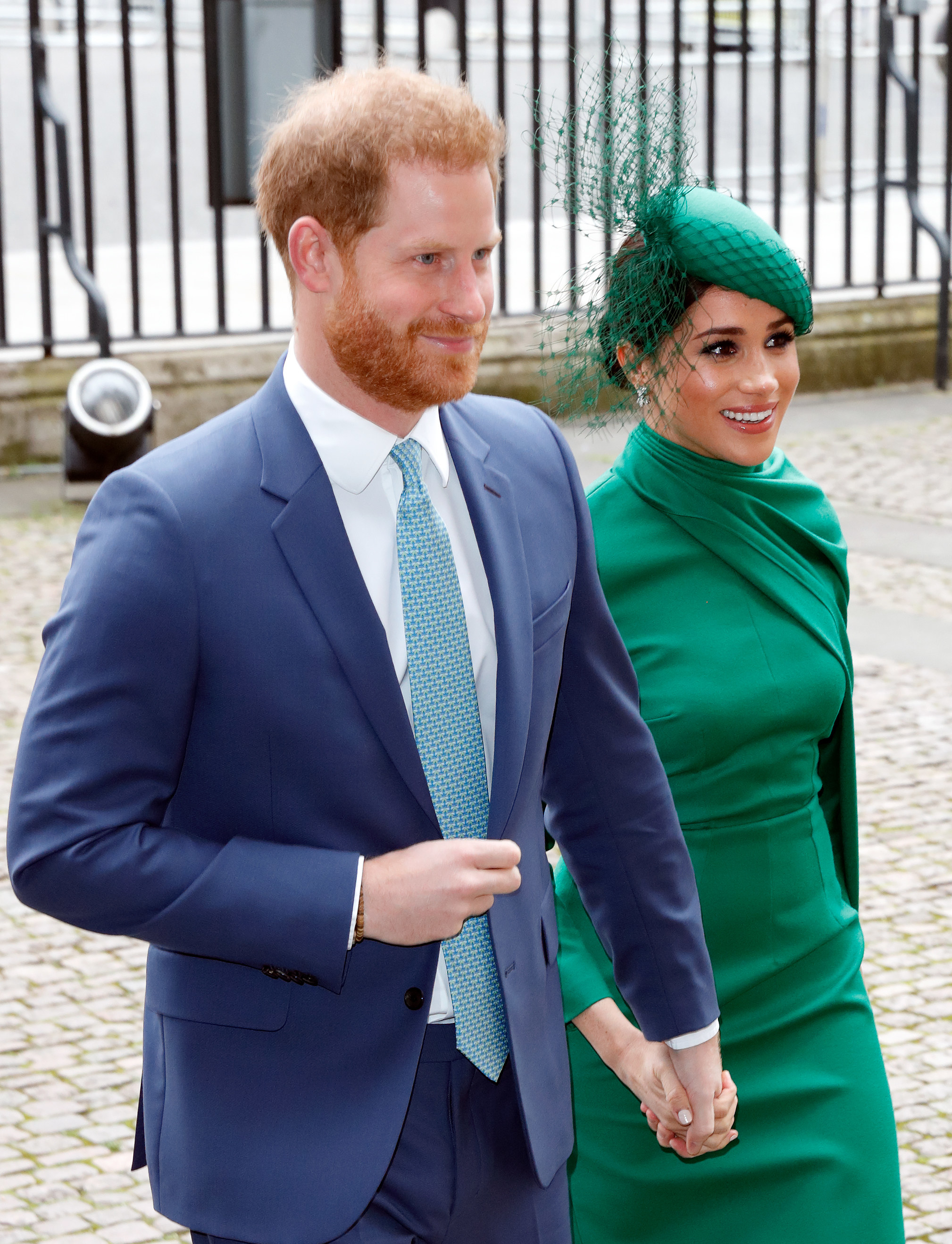 prince harry and meghan markle walking hand in hand