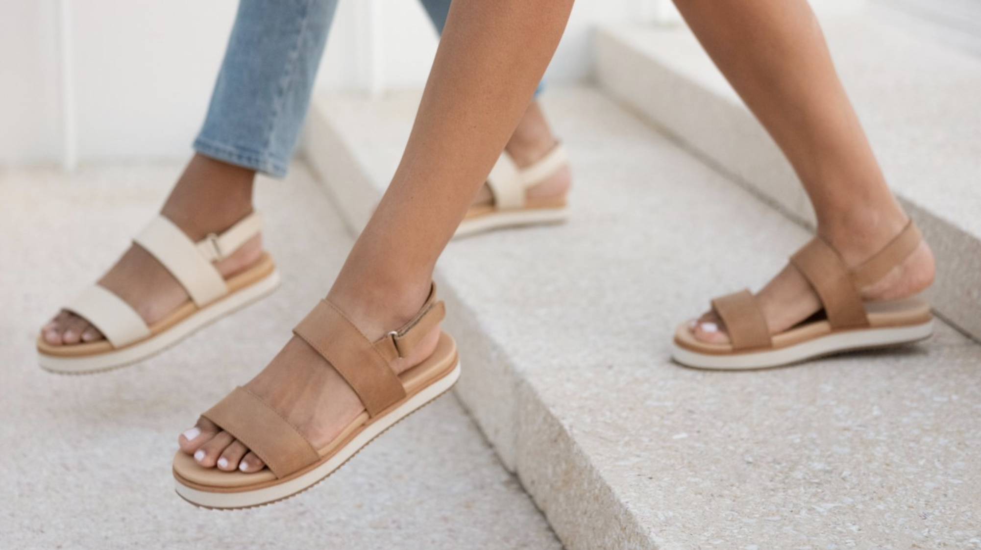 models wearing brown and white sandals