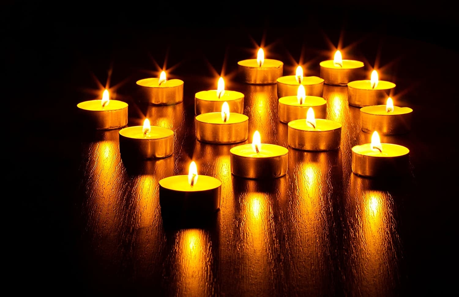 Several tiny candles aflame