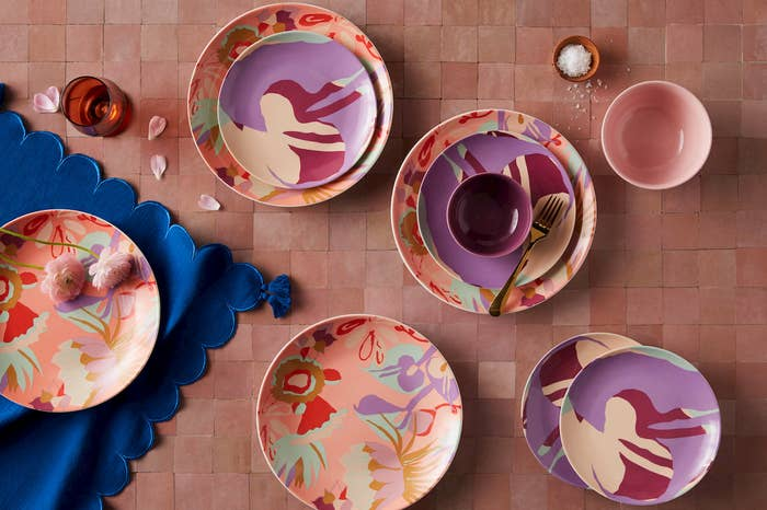the purple, coral, pink, and mint floral dinner plates, purple, mint, magenta, and peach salad plates, and solid purple and pink bowls