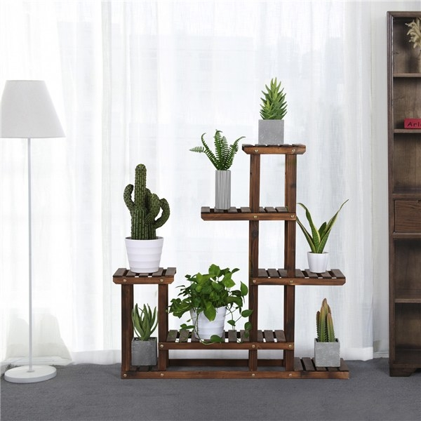 the shelves with plants on them next to a lamp