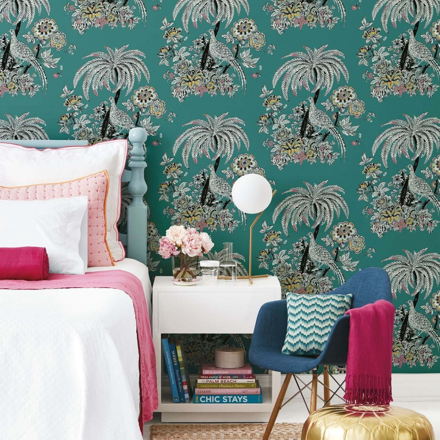 teal wallpaper with pink and yellow flowers and black and white peacocks
