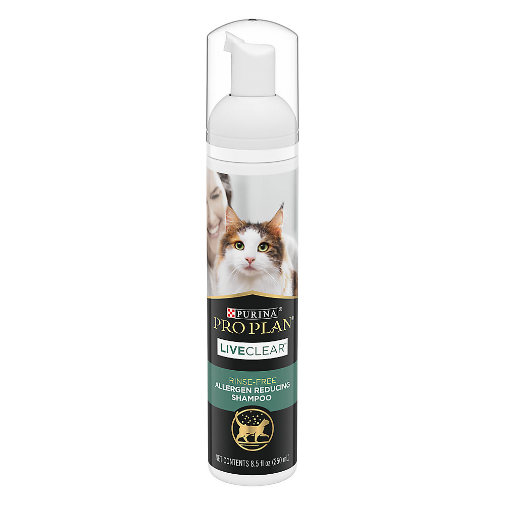 A black, white and green bottle of cat shampoo