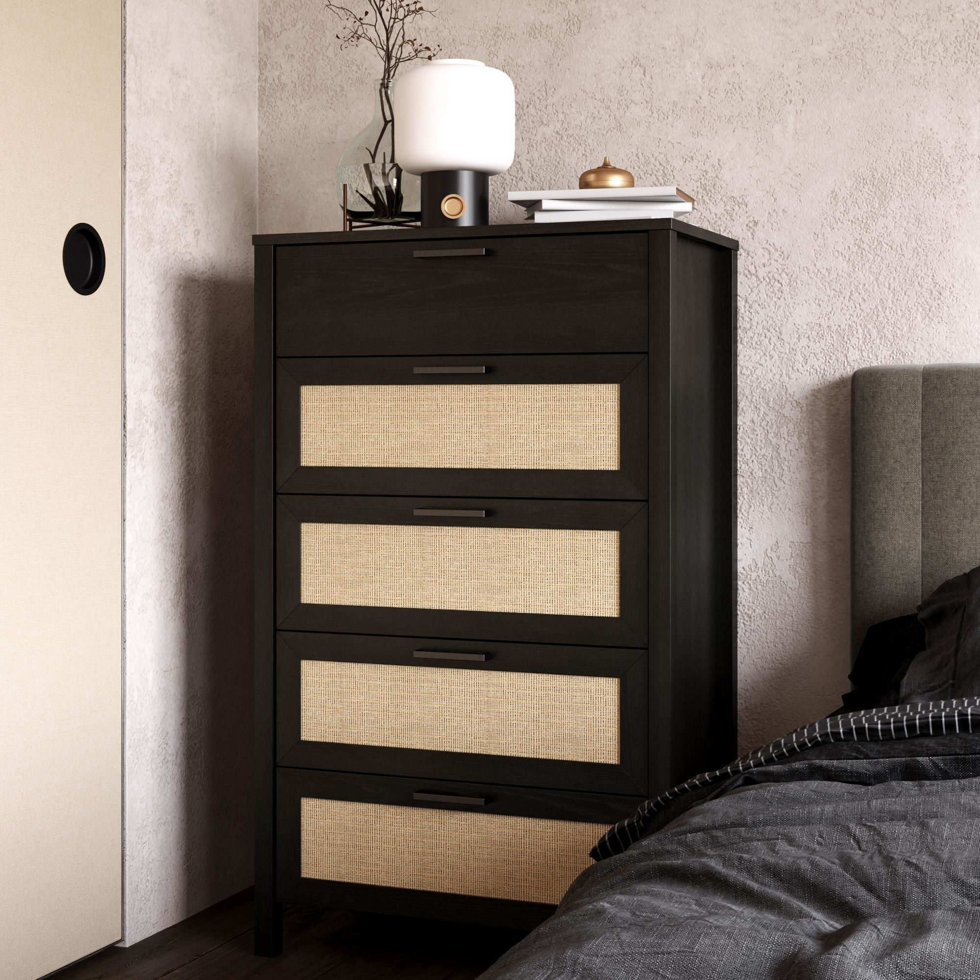 the dark faux wood dresser with light particle board drawers