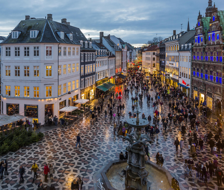 a busy street at night in Copenhagen