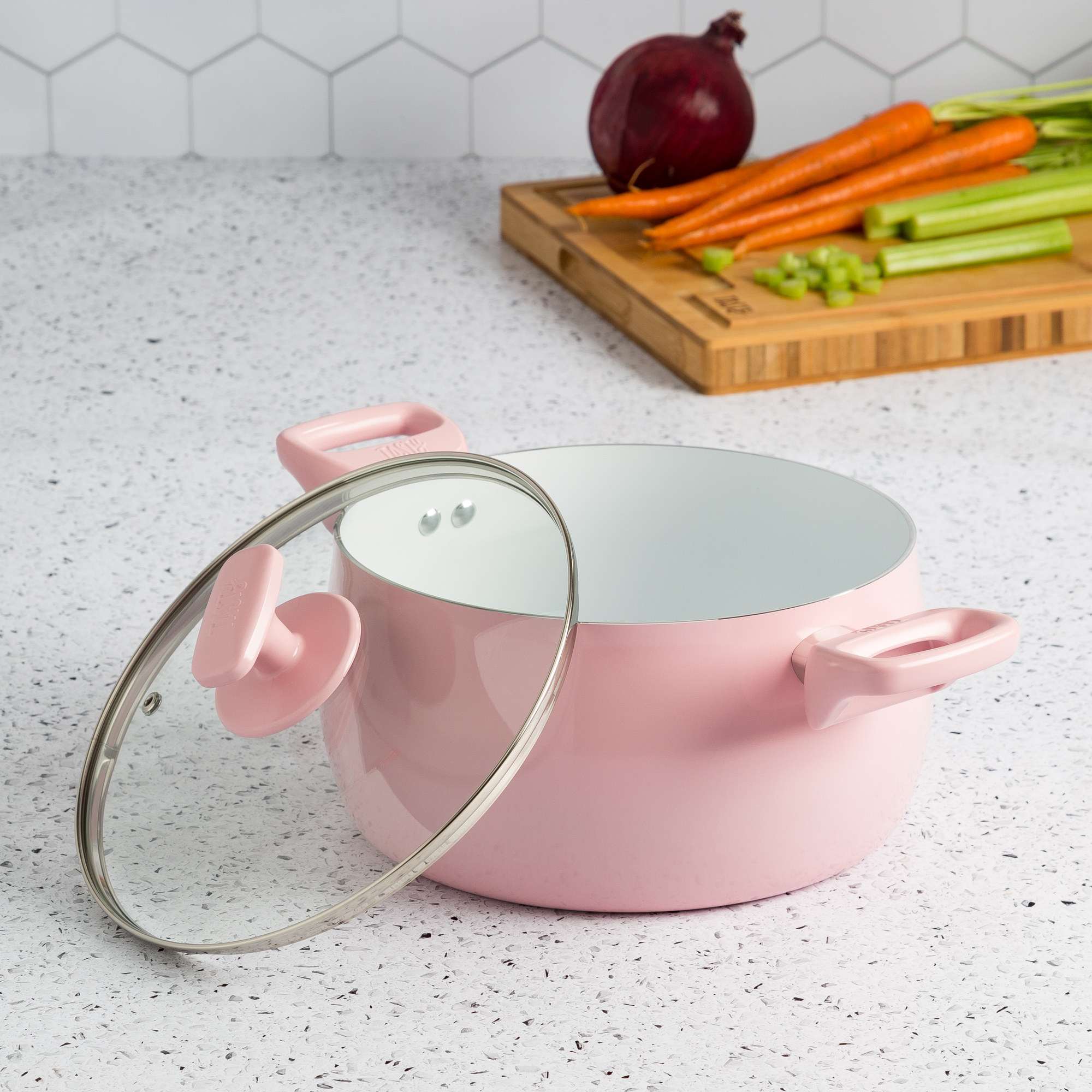 light pink pot with clear lid and chunky handles