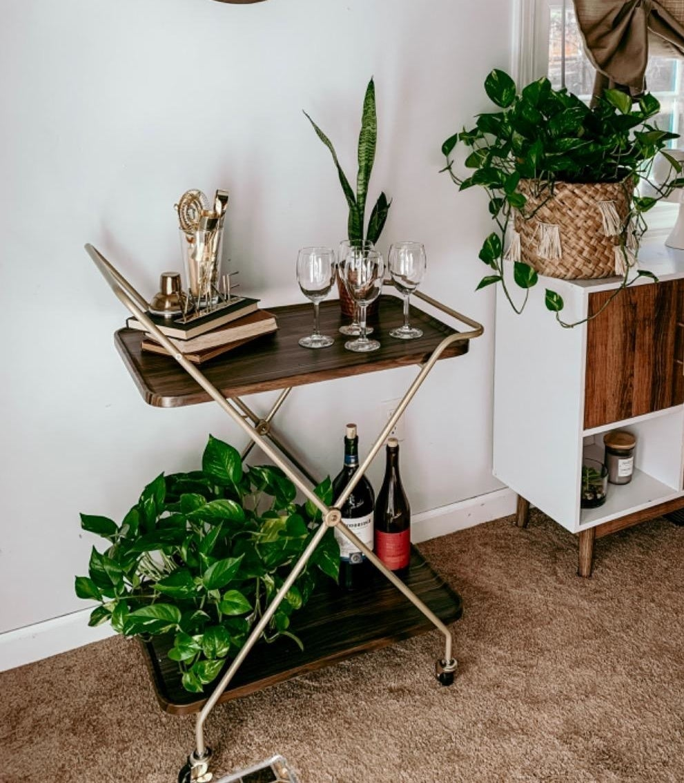 the wooden and gold bar cart
