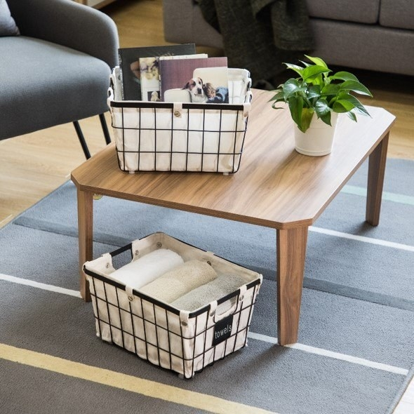 the small baskets holding towels and magazines
