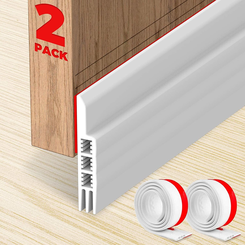 a white draft-blocker on the bottom of a door