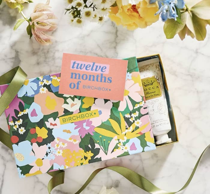 floral-print Birchbox subscription box with skincare products inside