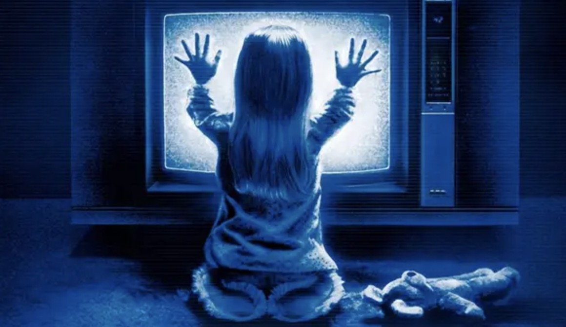 The image of Carol Anne touching a TV playing static from the film's poster