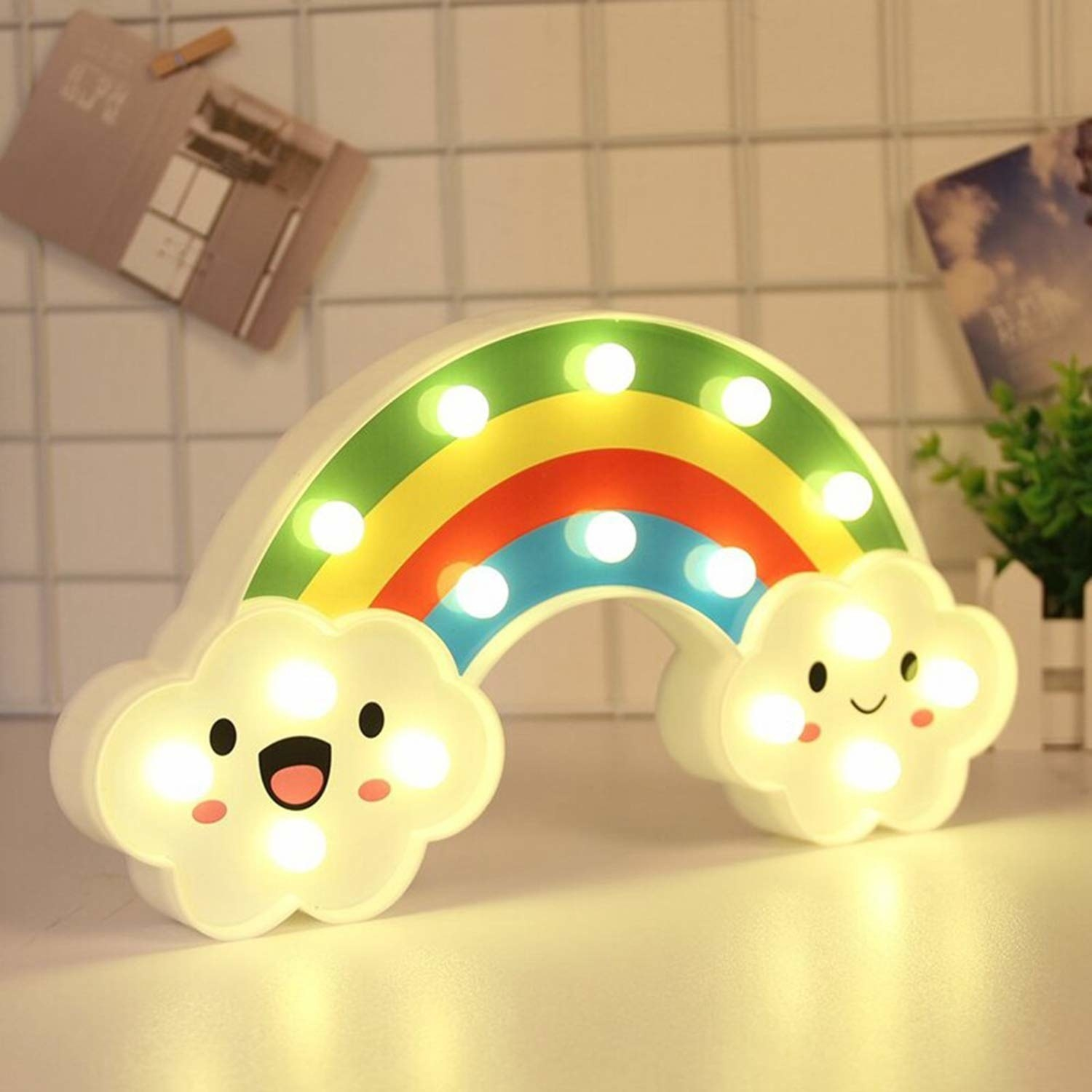 A rainbow night light with clouds at both ends.